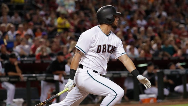 Arizona Diamondbacks' David Peralta follows through on a base hit against the Colorado Rockies during the fifth inning of a baseball game, Friday, June 30, 2017, in Phoenix.