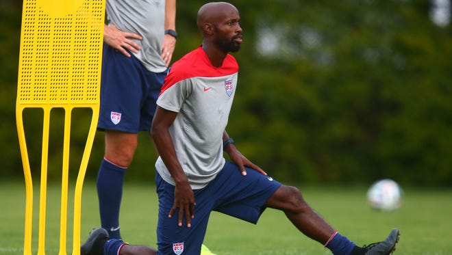 Jun 28, 2014; Sao Paulo, BRAZIL; USA defender DaMarcus Beasley stretches during team training at Sao Paulo FC. Mandatory Credit: Mark J. Rebilas-USA TODAY Sports