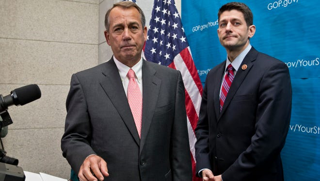 House Speaker John Boehner, left,  joined by House Budget Committee Chairman Rep. Paul Ryan to take questions on Capitol Hill Dec. 11.