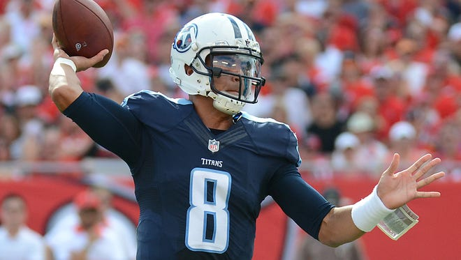 Sep 13, 2015; Tampa, FL, USA; Tennessee Titans quarterback Marcus Mariota (8) throws a touchdown pass  in the first half against the Tampa Bay Buccaneers at Raymond James Stadium. Mandatory Credit: Jonathan Dyer-USA TODAY Sports