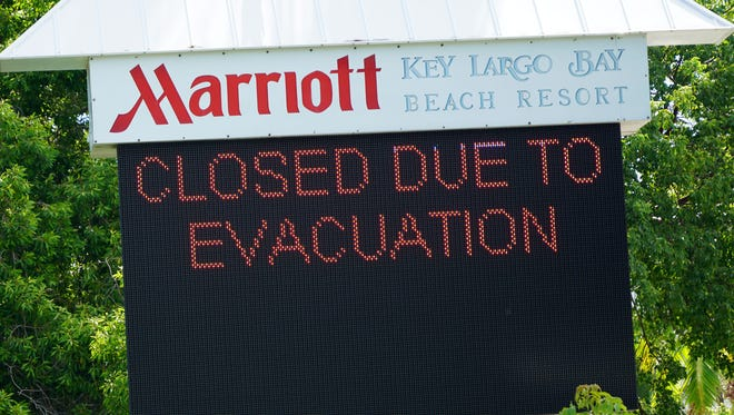 A sign at the Marriott Key Largo Bay resort alerts customers that it's closed due to the Hurricane Irma evacuation from the Florida Keys.