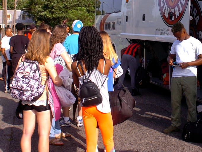 Students board a  bus for a trip to Washington DC.