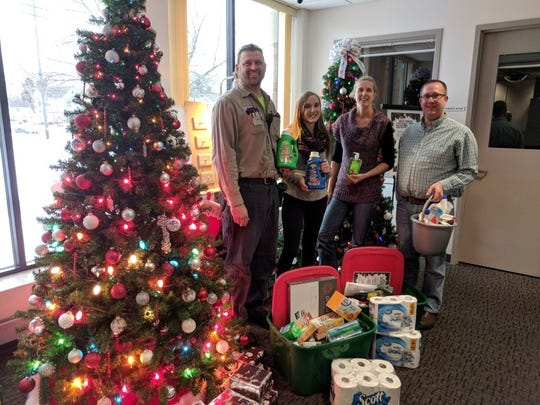 Manitowoc Public Utilities employees dedicated their Giving Tree to The Haven and Hope House. Pictured, from left: Ben Waterman, Karissa Leifer, Becky Olson and Mike Powalisz.