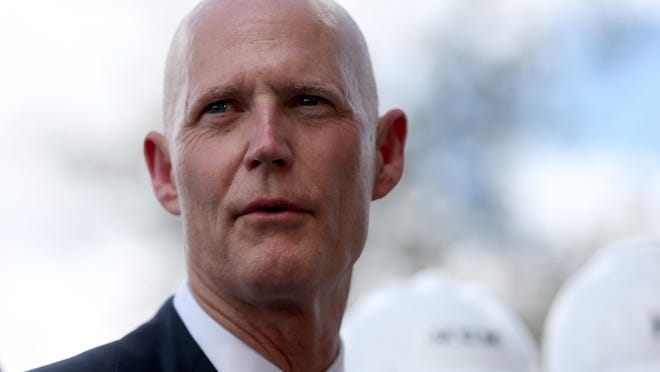 """HIALEAH, FL - MARCH 09: Florida Governor Rick Scott attends a road expansion event at the Casa Maiz restaurant as he fields questions from reporters about climate change on March 9, 2015 in Hialeah, Florida. Recent reports indicate that the Florida governor allegedly issued orders for certain state agencies to not to use the term """"climate change"""" or """"global warming"""" in any official communications, emails, or reports. (Photo by Joe Raedle/Getty Images)"""