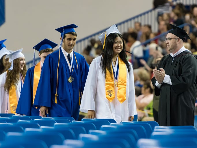 Students enter the auditorium in a processional march