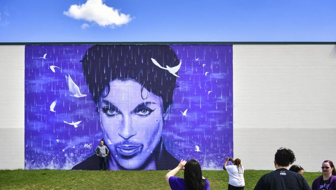 Prince fans gathered at the Prince mural on the side of the Chanhassen Cinema on Friday in Chanhassen, Minn.