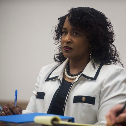 LAMP teacher Monica McCord listens to board member
