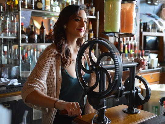 Sarah Soyk uses the Steampunk Shaker to make the Green Eyed Devil and Steve McQueen cocktails at Standard & Co., 1139 Main Street in Green Bay.