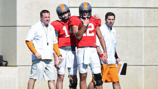 Tennessee quarterbacks Zac Jancek (14) and Quinten Dormady (12) work with coach Butch Jones, left, and offensive quality control Nick Sheridan during spring practice at Haslam Field on Tuesday.