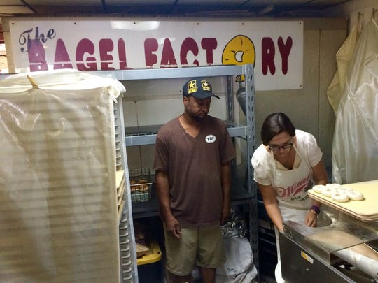 "The News-Press food writer Anne Reed tries her hand at bagel making on The Bagel Factory's ""I Love Lucy"" machine."