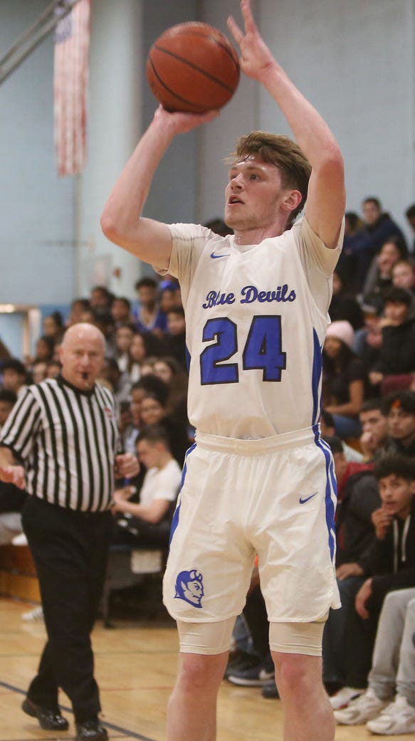 Saunders' Sean Bresnon (24) puts up a shot against