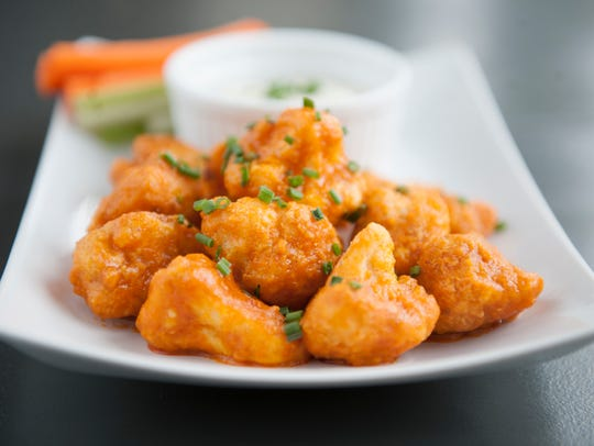 These Buffalo Cauliflower Bites are a hit at Leaf. They are baked and tossed with buffalo sauce, and served with a housemade blue cheese dressing.
