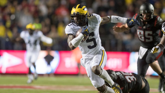 Michigan linebacker Jabrill Peppers runs for a touchdown in the first quarter.  The play was called back due to penalty.