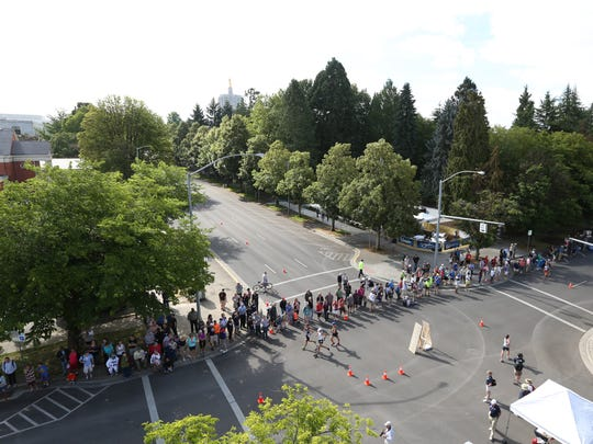 Spectators line Cottage Street to watch the 20-kilometer race walk during the U.S. Olympic Track & Field Team Trials on Thursday, June 30, 2016, in Salem, Ore.