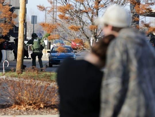 Bystanders watch as officers from multiple agencies
