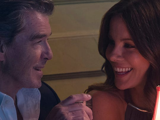 "Kate Beckinsale and Pierce Brosnan share a moment in ""The Only Living Boy in New York."""