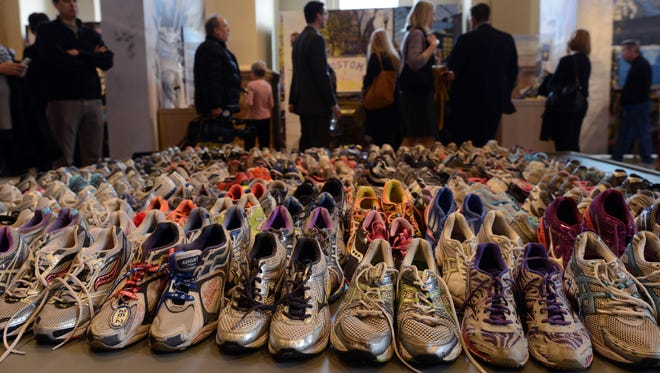 A Boston Marathon memorial exhibition at the Boston Public Library on April 7.