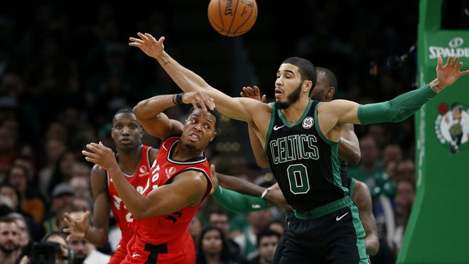 Raptors guard Kyle Lowry, who is averaging 19.7 points, 7.6 assists and 5.1 rebounds, passes past Celtics forward Jayson Tatum during a December game at TD Garden.