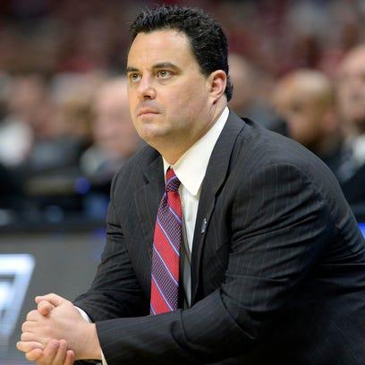 Arizona Wildcats head coach Sean Miller watches game