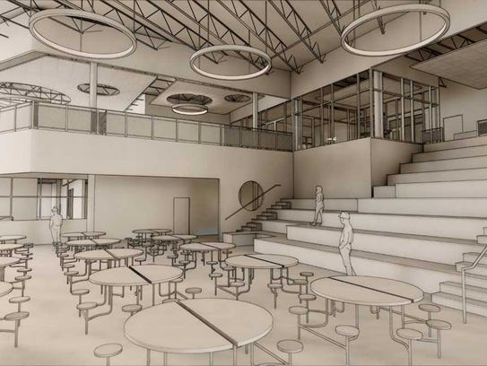 An interior rendering of the new Meadow View Elementary School in Oconomowoc shows a cafeteria seating area, library on the upper level, tiered seating for student/teacher instruction and collaboration and a gathering space.