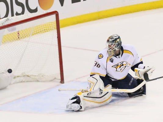 635870305275618534-Predators-Blues-Hockey.jpg