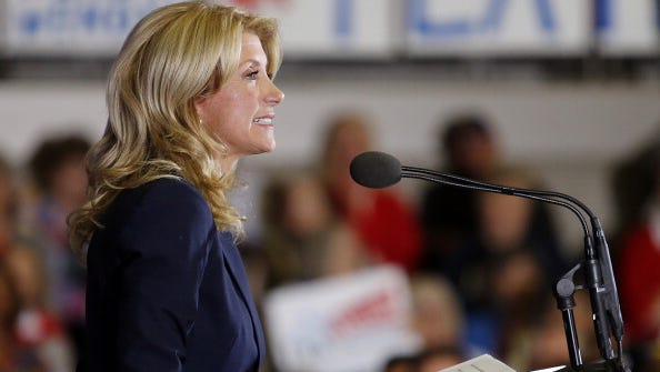 HALTOM CITY, TX - OCTOBER 3: Texas State Sen. Wendy Davis (D) speaks at the podium as she announces her intentions to run for Texas Governor at the W.G. Thomas Coliseum in Haltom City on October 3, 2013 in Haltom City, Texas. Davis, who entered the national spotlight after holding a filibuster on a Texas abortion bill, announced her intentions to run for Texas Governor at the same location where she accepted her high school diploma. (Photo by Stewart F. House/Getty Images)