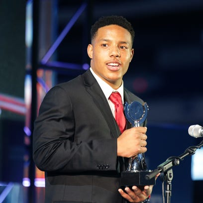 Desmond Bane, Seton Catholic High School, accepts the award for Male Athlete of the Year. IndyStar held the Indiana Sports Awards, Thursday, April 28, 2016 at Lucas Oil Stadium where they honored the outstanding accomplishments of 200+ high school athletes in 28 sports. The featured guest speaker was Indianapolis Colts' quarterback Andrew Luck. The evening's host was WNBA Indiana Fever Head Coach Stephanie White. Celebrity presenters included Indiana Fever All-Star Tamika Catchings, IndyCar driver Ed Carpenter and IndyStar's own sports columnist Gregg Doyel.