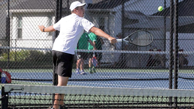 Garrett Meyer hits a return shot in one of his matches at fourth singles Saturday at Augspurger Courts.