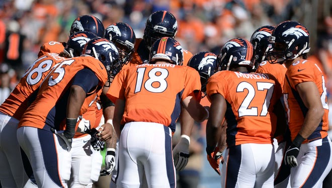 Broncos QB Peyton Manning (18) is getting plenty of help from his offensive mates.