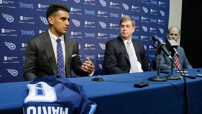 Marcus Mariota, left, former Oregon quarterback and overall No. 2 NFL football draft pick by the Tennessee Titans, answers questions during a news conference Friday, May 1, 2015, in Nashville, Tenn. With Mariota are Titans general manager Ruston Webster, center, and head coach Ken Whisenhunt, right. Mariota was selected by the Titans in the first round Thursday.