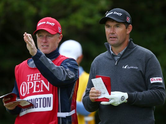 Ireland's Padraig Harrington looks along the 5th fairway with his caddie during the first round of the British Open Golf Championship, at Royal Birkdale, Southport, England Thursday, July 20, 2017. (AP Photo/Dave Thompson)