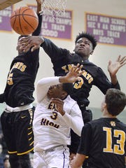 McQuaid's Isaiah Stewart, top, blocks a shot by East's