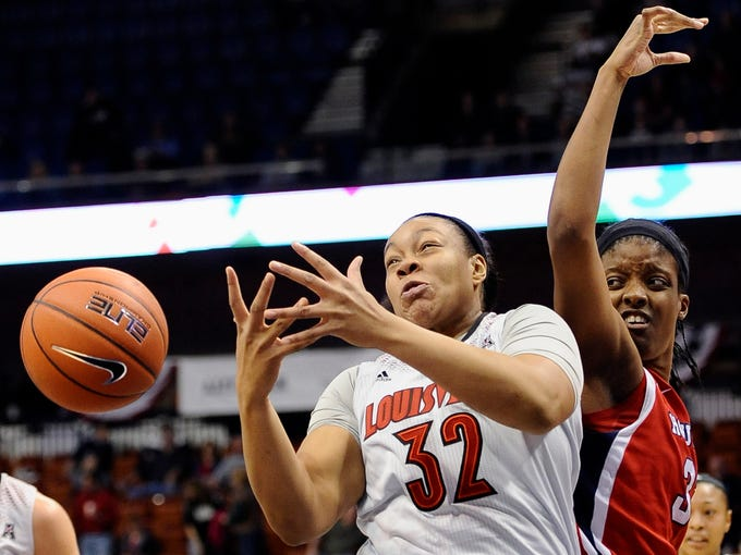 A rebound is out of reach for Louisville's Emmonnie Henderson, left, and Houston's Marche' Amerson, right, during the first half of an NCAA college basketball game in the quarterfinals of the American Athletic Conference women's tournament, Saturday, March 8, 2014, in Uncasville, Conn. (AP Photo/Jessica Hill)