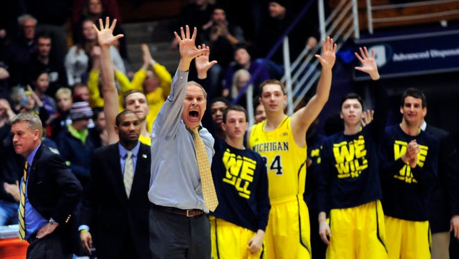 Michigan Wolverines head coach John Beilein shouts instructions against Northwestern.