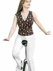 Author and former Citizen Times columnist Susan Reinhardt could always liven up the office by taking a spin on her unicycle.