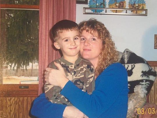 Bellevue quarterback Gino Costello with his mom Sandi