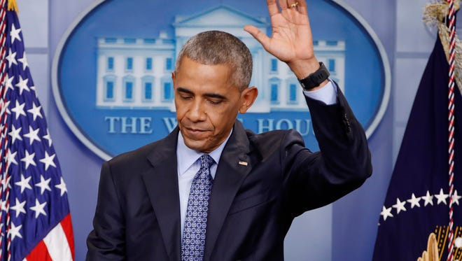 President Barack Obama waves at the conclusion of his final presidential news conference, Wednesday, Jan. 18, 2017, in the briefing room of the white House in Washington.