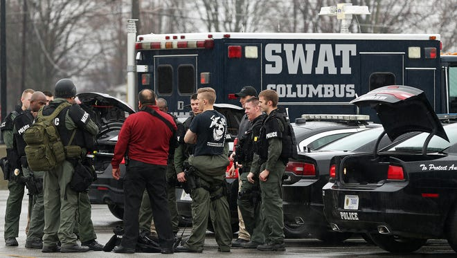 Emergency personnel gather in the parking lot of Cummins Engine Plant in Seymour, Ind., after two employees died in an apparent murder-suicide Thursday morning, March 10, 2016.