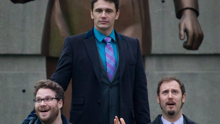 Seth Rogen, left, and James Franco, top, and producer Evan ...