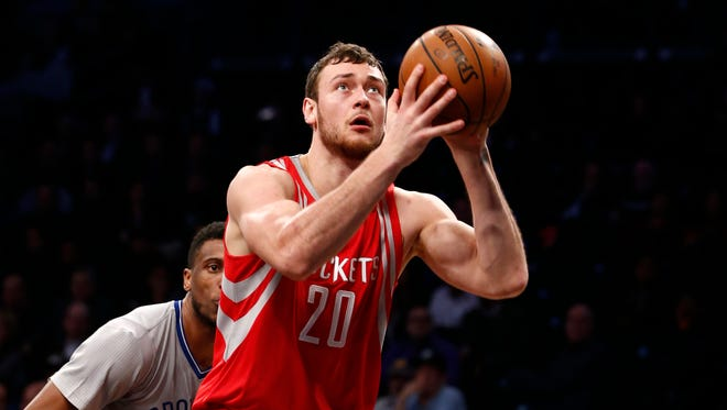 Houston Rockets forward Donatas Motiejunas (20) prepares to shoot in the first half of an NBA basketball game, Tuesday, Dec. 8, 2015, in New York.