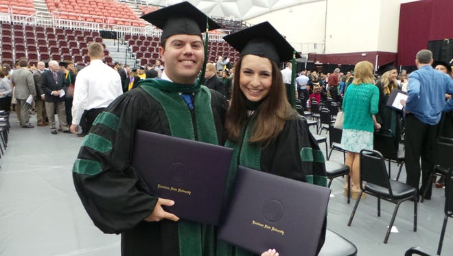 Alexandria natives Sarah Wilson and Matt Ayo pose holding their degrees from LSU Health Sciences Center in Shreveport. The pair graduated in May after attending school together for 21 years at Our Lady of Prompt Succor School, Holy Savior Menard Central High School, Louisiana State University in Baton Rouge, and eventually, medical school.