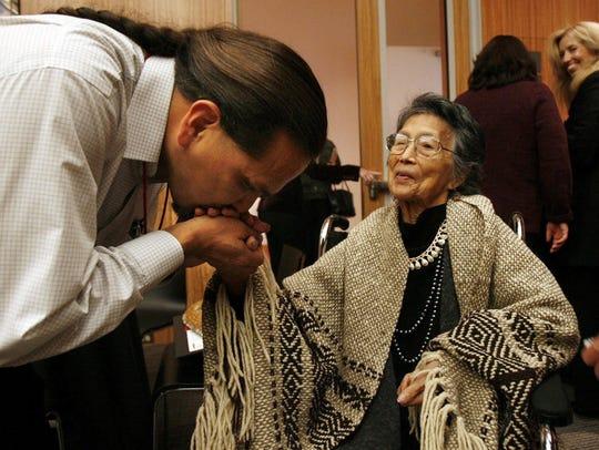 Upper Skagit tribal elder Vi Hilbert is greeted by