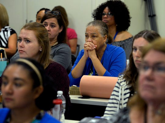 School nurses listen in a session on how to treat shooting victims at the Lentz Public Health Center on Wednesday,.