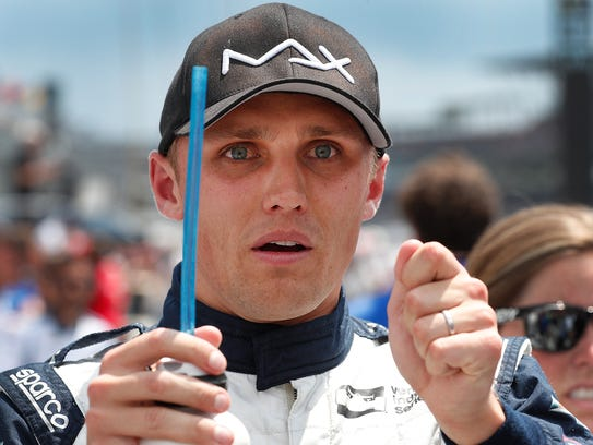 Team Carlin IndyCar driver Max Chilton (59) shows what