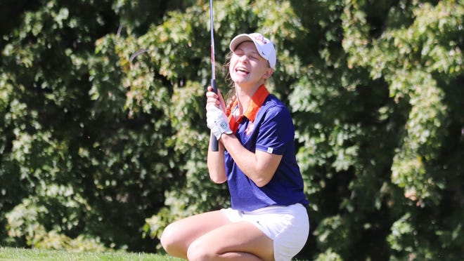 Pontiac Township High School's Dani Grace Schrock reacts after her birdie putt dropped into the cup on the 12th hole at the Elks Club Wednesday. Schrock was participating with her PTHS and other schools, including Prairie Central and El Paso-Gridley, at the Pontiac Regional girls' golf tournament. Final results were not known at deadline.