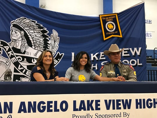 Lake View High School's Veronica Diaz celebrates signing a national letter of intent to run track for Texas A&M-Commerce on Wednesday, April 25, 2018. With her are her parents, Martha and Carlos Diaz.