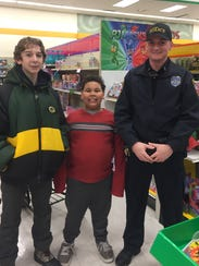 Connor Smith and Julian with Officer Tanner during
