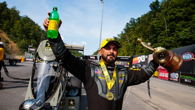 NHRA Top Fuel driver Tony Schumacher celebrates after winning the Thunder Valley Nationals at Bristol Dragway.