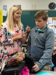 Math teacher Megan Beard (left) answers a question