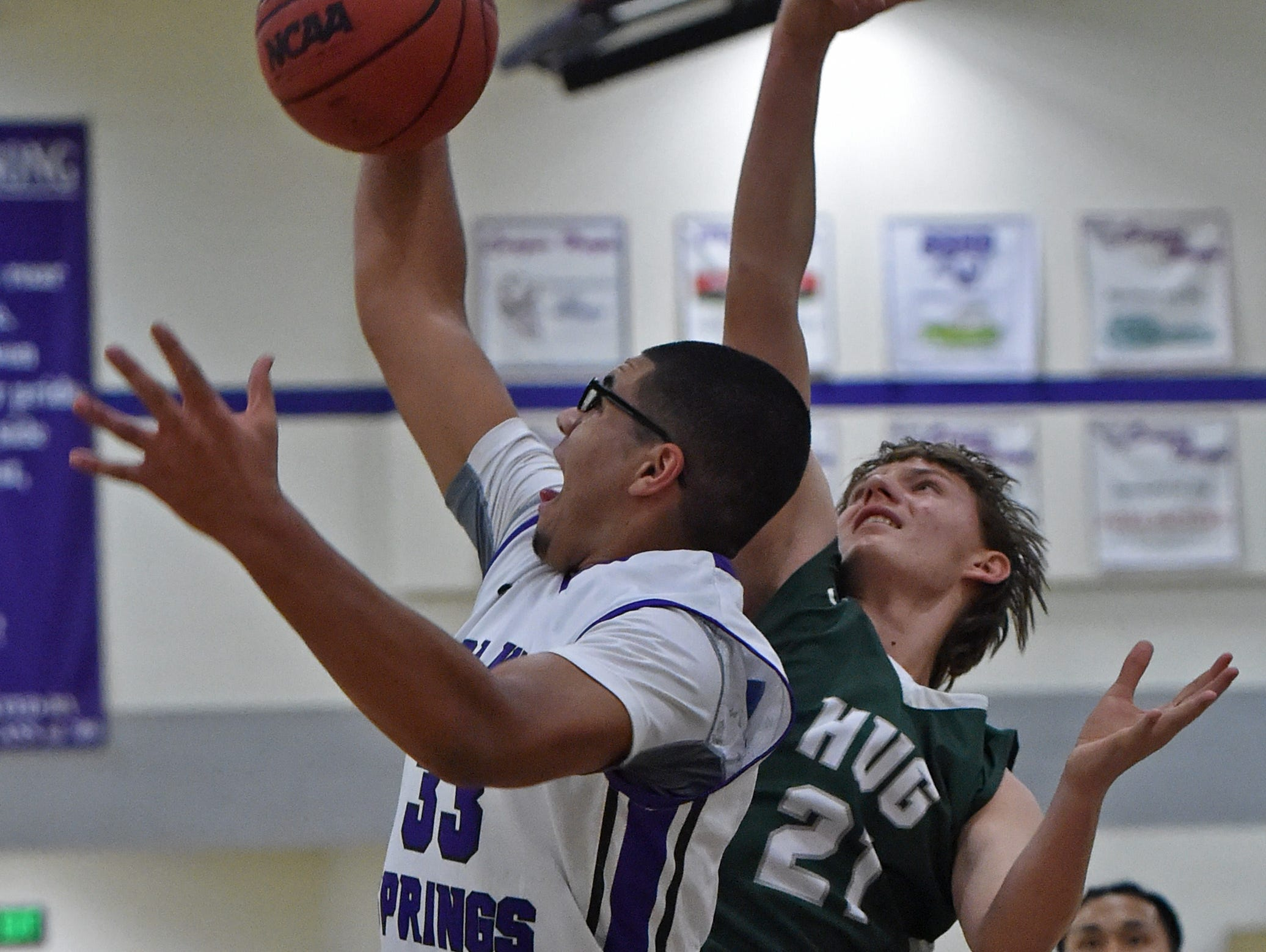 Spanish Springs' Marcus Loadholt beats Hug's Drake Newman to a rebound during the first half of Tuesday's game at Spanish Springs